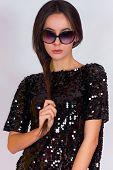 image of little black dress  - Beautiful brunette girl in a black dress and glasses - JPG
