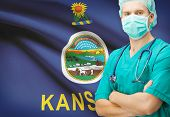 foto of kansas  - Surgeon with US state flag on background  - JPG