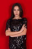 image of little black dress  - Beautiful brunette girl in a black dress with brown eyes - JPG