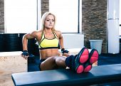 foto of bench  - Beautiful sporty woman workout at gym on bench and fit box - JPG