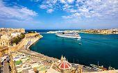 stock photo of leaving  - Cruise liner leaving Valletta port  - JPG