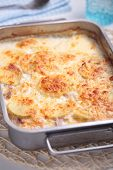 picture of baked potato  - Potatoes a la dauphinoise in a baking dish - JPG