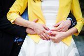 image of wedding  - Newly wed couple embracing  - JPG