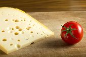 picture of wood pieces  - One piece of cheese over wood background - JPG