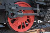 image of locomotive  - Closeup of red color wheel of historical steam locomotive - JPG