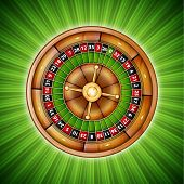 image of roulette table  - Green background with casino roulette - JPG