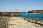stock photo of arid  - The bay of Salinas in the town of Sao Jorge on the island of Fogo Part of Republic of Cabo Verde with its dry arid aroma during a sunny afternoon. ** Note: Visible grain at 100%, best at smaller sizes - JPG