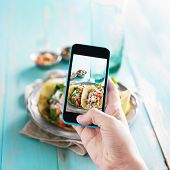 stock photo of tacos  - taking photo of tacos with smart phone - JPG