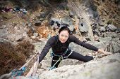 picture of climbing wall  - Young woman climbing wall active woman concept picture - JPG