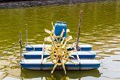 image of oxygen  - Water turbine fill oxygen into water in lake - JPG