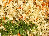 pic of mixture  - Mixture of various ingredients for preparing a salad with finely chopped cabbage carrots dill and green onions close - JPG