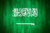 picture of saudi arabia  - Saudi Arabia flag or Saudi Arabian banner on wooden boards background - JPG