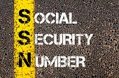 picture of social-security  - Acronym SSN as Social Security Number. Yellow paint line on the road against asphalt background. Conceptual image - JPG