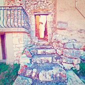 image of french culture  - Door in the Wall of the Old French House Leading to the Deserted Street Instagram Effect - JPG