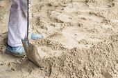 pic of spade  - man digging in the ground with shovel and spade - JPG