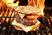 stock photo of bbq party  - BBQ Beef Burger On The Hot Flaming Grill - JPG