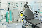 picture of anesthesiology  - interior of the operating room in dental clinic with the anesthesiology machine on the frontground - JPG