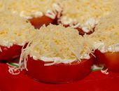 stock photo of grating  - tomato slices covering grated cheese garlic fresh
