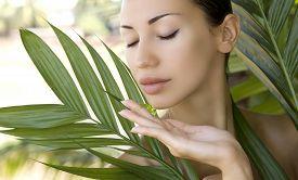 pic of gels  - Beautiful caucasian woman holding natural aloe vera facial gel skin care and wellness - JPG