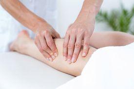 stock photo of physiotherapist  - Physiotherapist doing leg massage in medical office - JPG