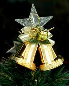 foto of christmas bells  - christmas bells and star against dark background - JPG