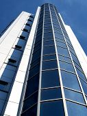 stock photo of building exterior  - High tech blue office building with exterior elevator - JPG