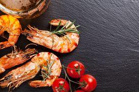 pic of shrimp  - Beer mug and grilled shrimps on stone plate - JPG