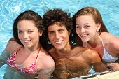 happy teenagers in swimming pool