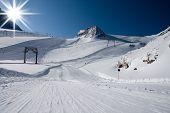 Ski slope under high mountains. Kaprun, Austria.