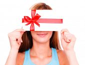 Holding gift card bonus female smiling