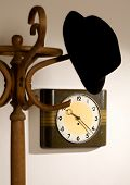 foto of peg-leg  - hat on a hanger with a clock in the background - JPG