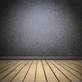 black room with wooden floor. with spotlight.