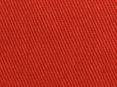 Red fabric high magnification texture. Red cotton fabric.