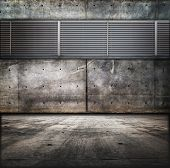 Grungy concrete room with vent