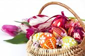 Basket full of Easter eggs and tulips