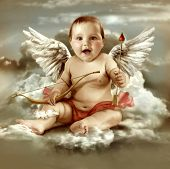 stock photo of cherub  - Baby cupid with angel wings - JPG