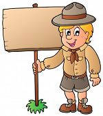 stock photo of boy scout  - Scout boy holding wooden board  - JPG