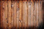 Parede de madeira sujo com unhas