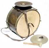Big vintage orchestral drum with cymbals and beater on white background