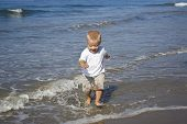 Little boy playing in the ocean