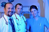 Medical doctors and a nurse at hospital emergency room intensive care - a series of emergency room p
