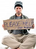 Studio shot of a homeless with asking for help - a series of HOMELESS images.