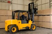 Forklift operator working at warehouse - a series of METAL INDUSTRY images.