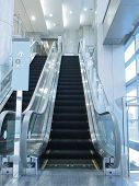 foto of department store  - Escalator in department store - JPG