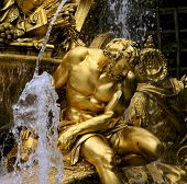 stock photo of versaille  - Fragment of fountain in park of Versailles - JPG