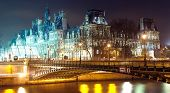 France - Paris  Hotel de ville and Seine river at night