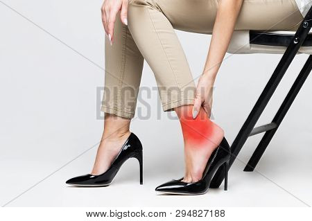 poster of Tired Woman Touching Her Ankle, Suffering From Leg Pain Because Of Uncomfortable Shoes, Feet Pain We