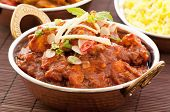 stock photo of curry chicken  - Chichen Madras with Rice as Closeup - JPG