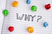 Why? Why Question On Notebook Sheet With Some Colorful Crumpled Paper Balls On It. Close Up. poster