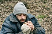 Poor Homeless Man With Cup In City Park poster